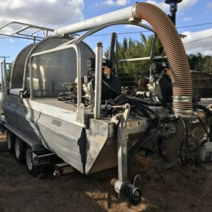 AQUATIC WEED HARVESTER BOAT ON TRI AXLE TRAILER